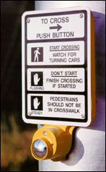 Push button activated crosswalk warning flash